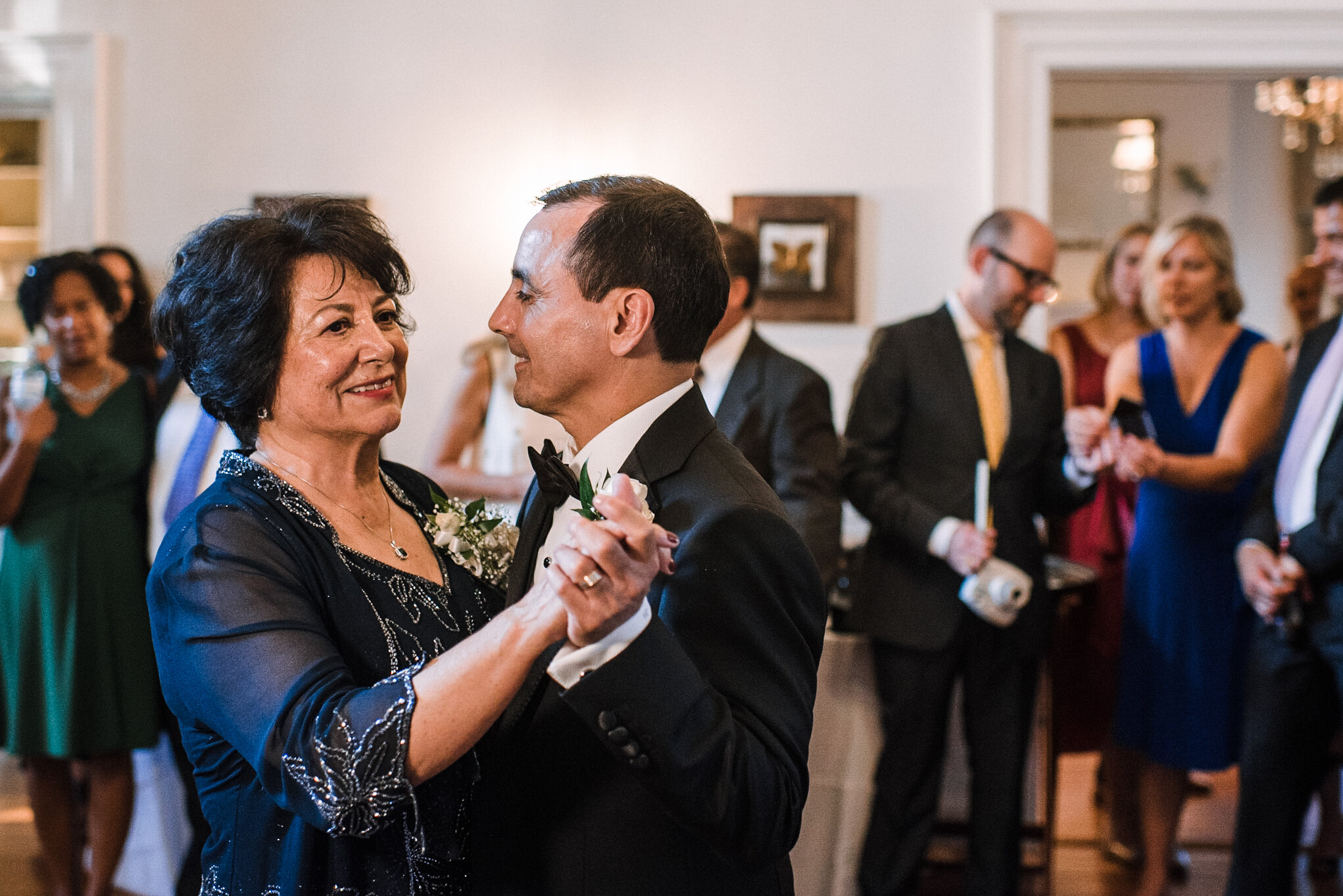 groom and mother dancing at reception at Rust Manor House