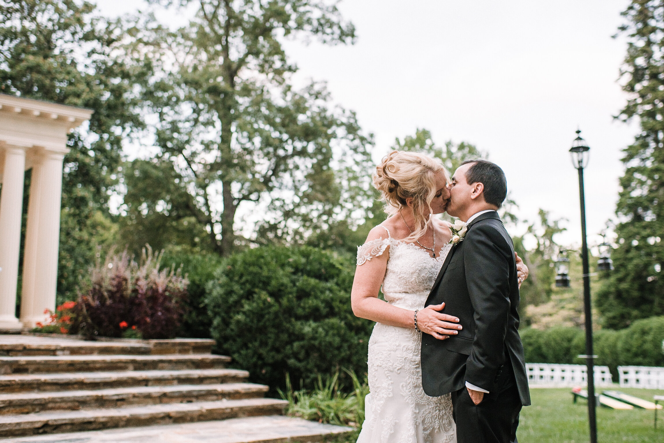bride and groom kissing at Rust Manor House