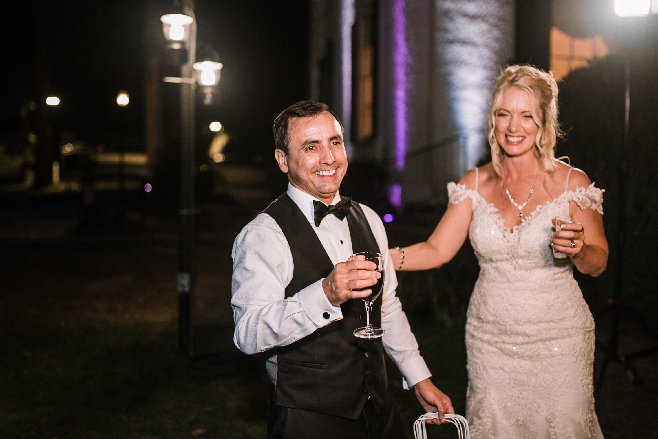 bride and groom smiling at reception at Rust Manor House