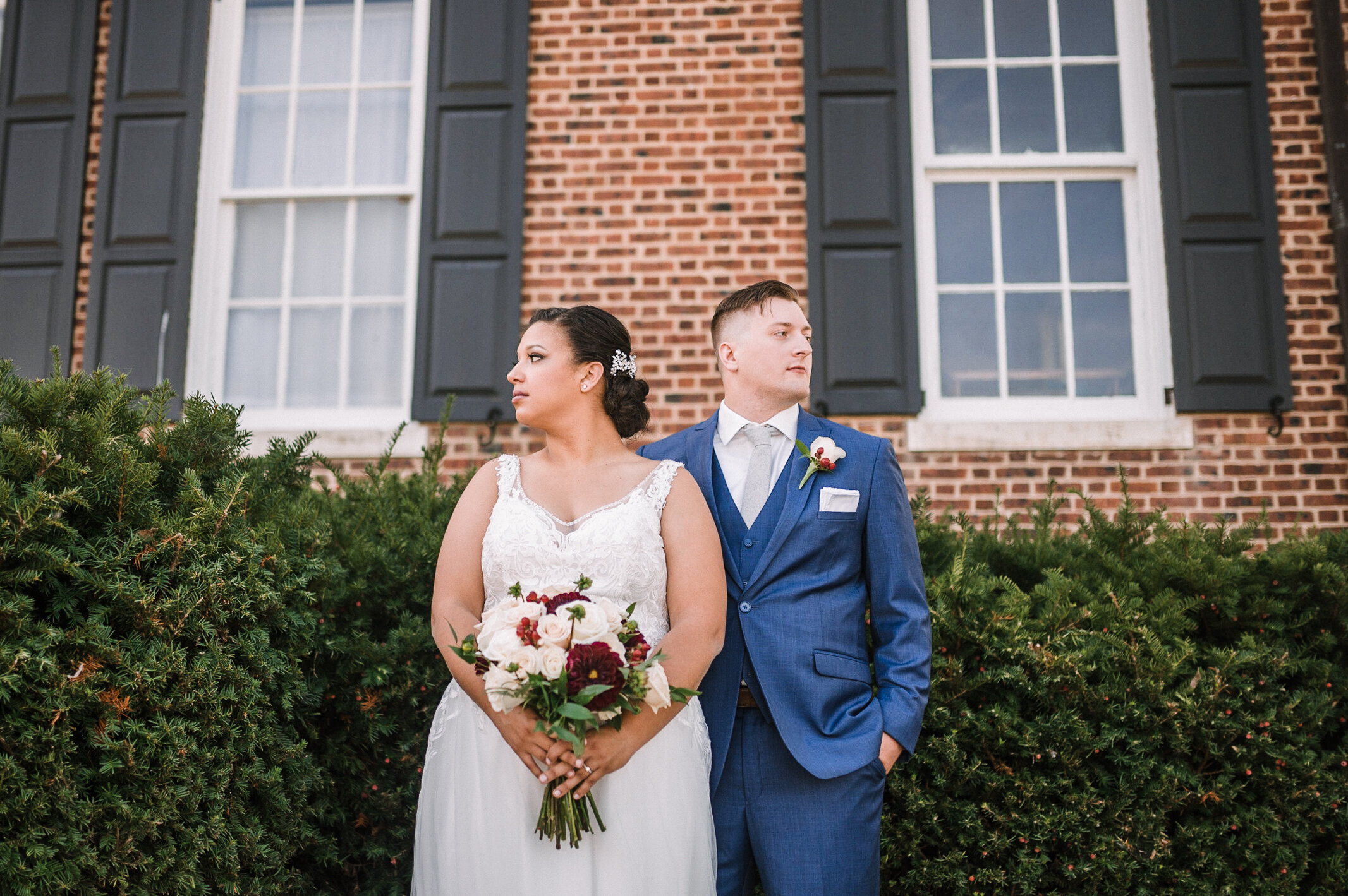 bride and groom posing at The Inn at Vint Hill