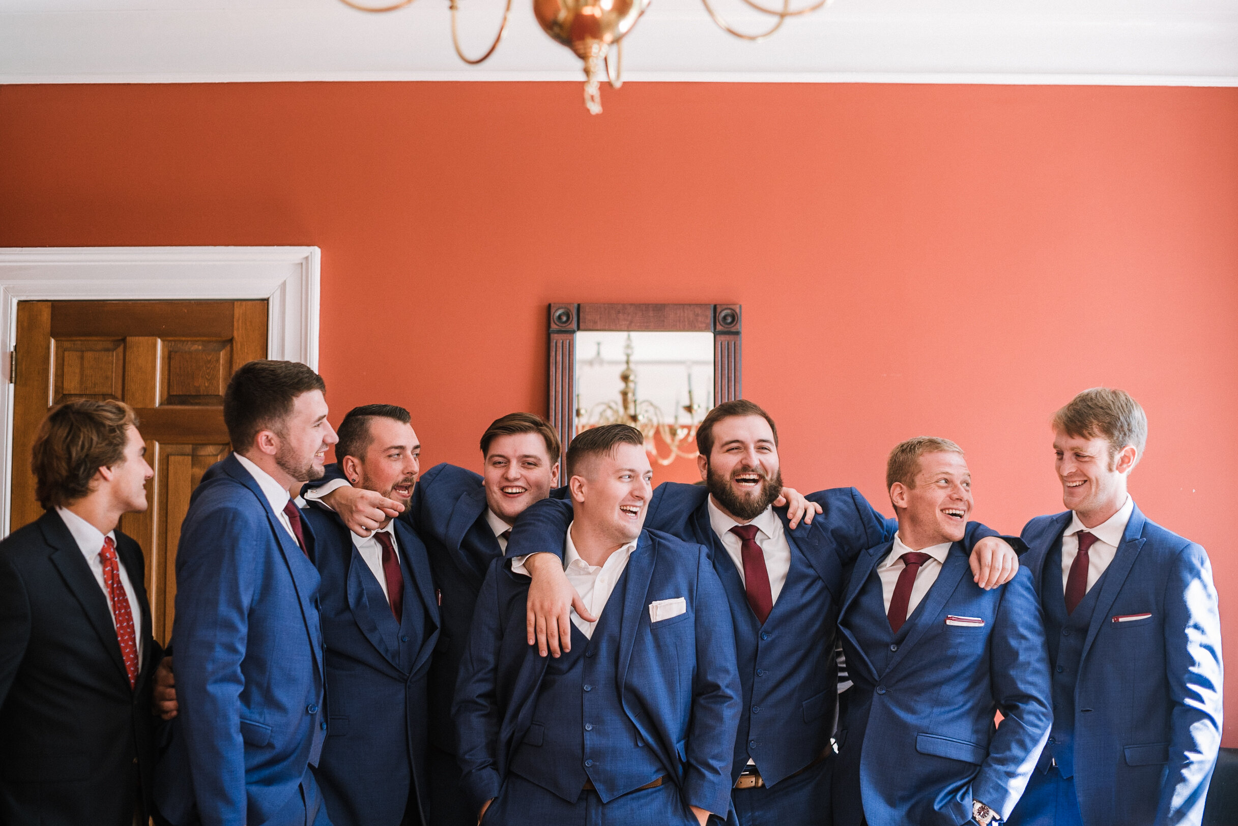 groom and groomsmen laughing as they get ready at The Inn at Vint Hill
