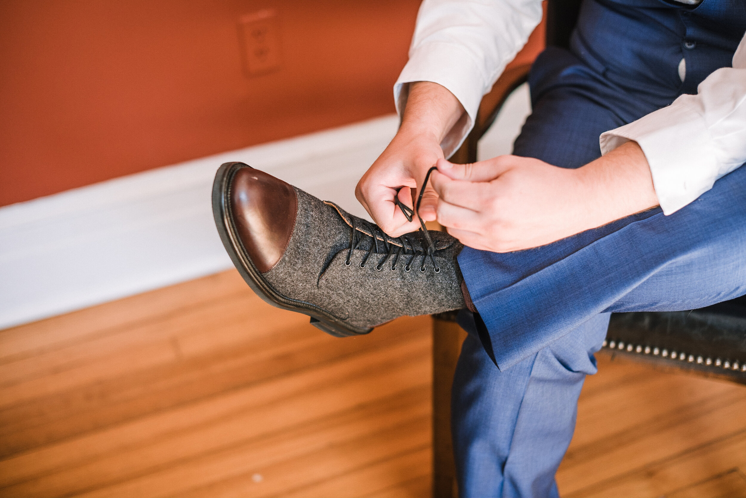 groom putting on shoes at The Inn at Vint Hill