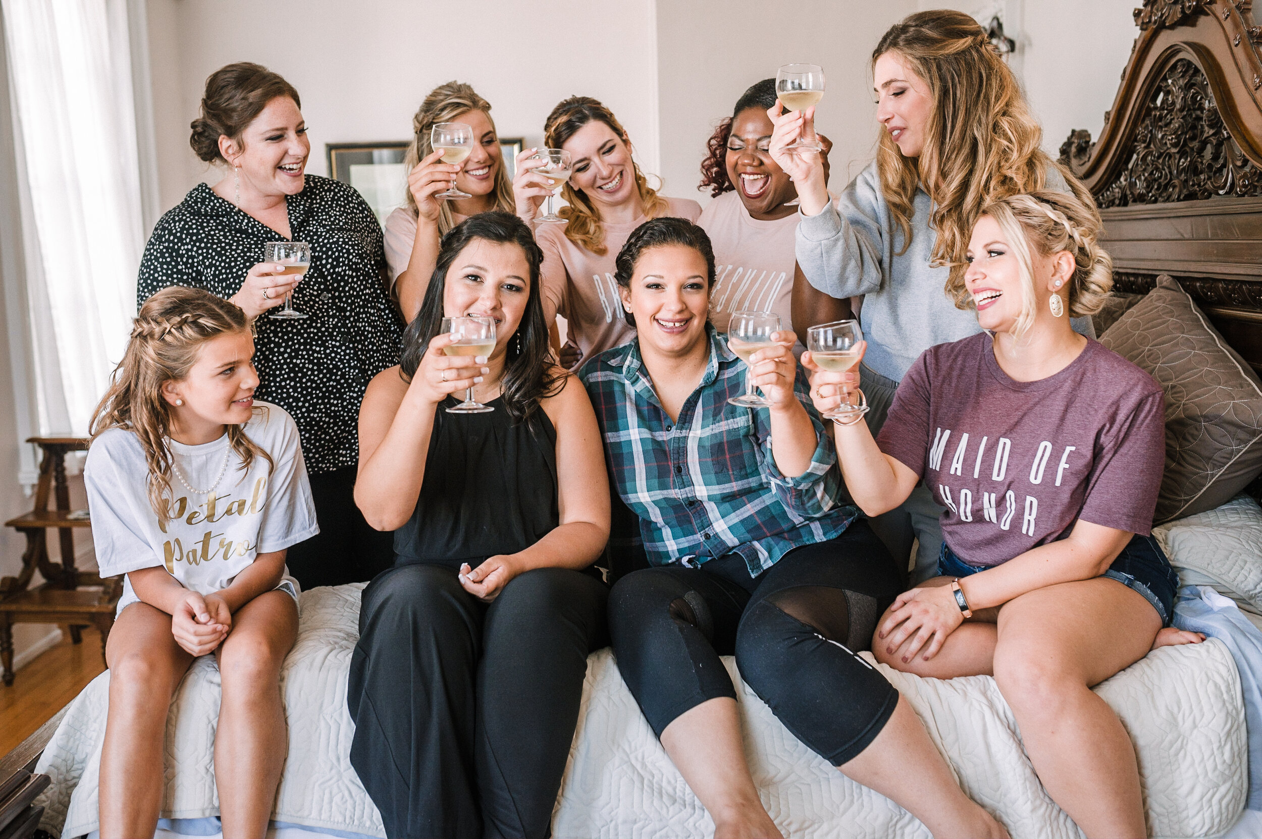 bride and bridesmaids drinking champagne at The Inn at Vint Hill