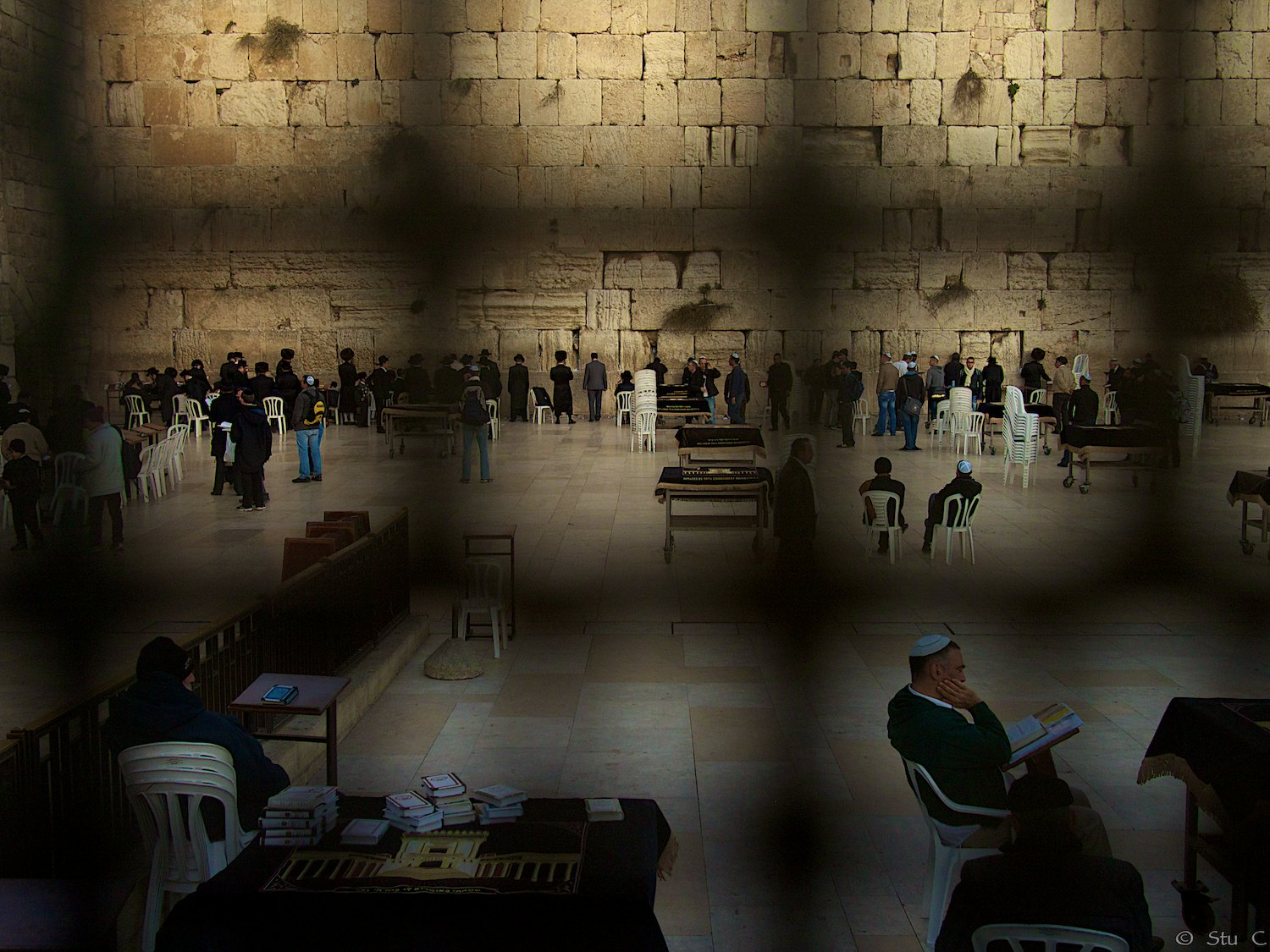Western Wall seen through security fence providing space for the devout, though entry is not prohibited to others