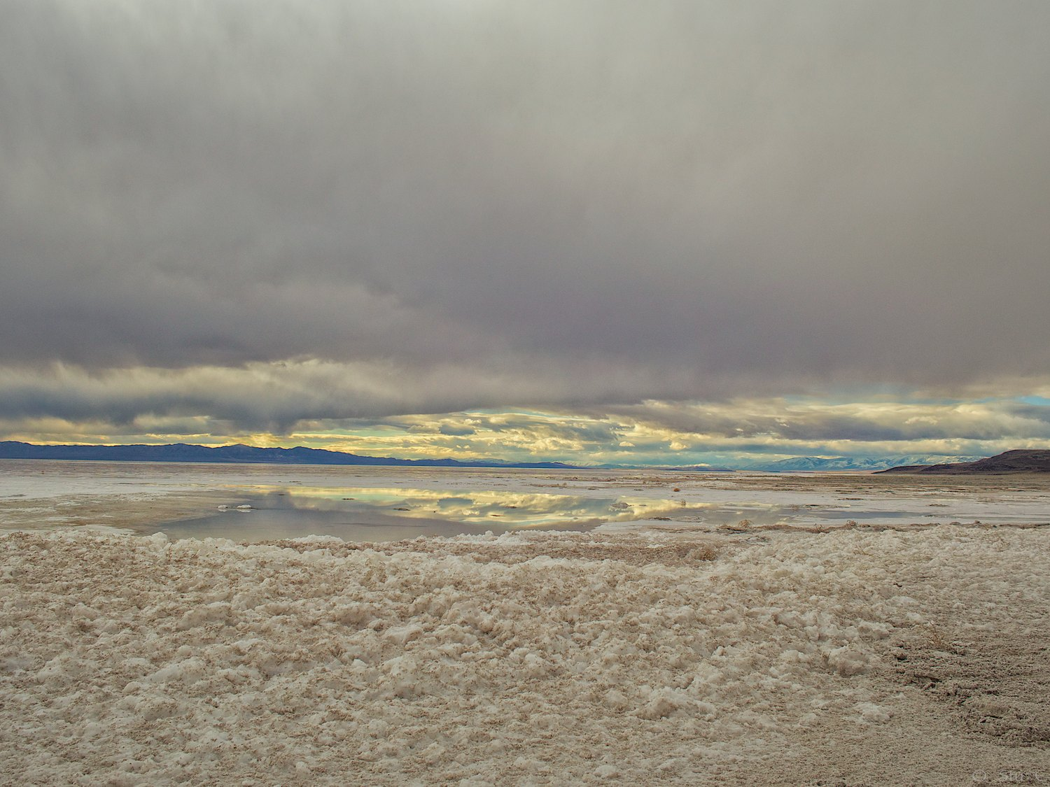 Remote sunset reflects in a salt pond on The Great Salt Lake