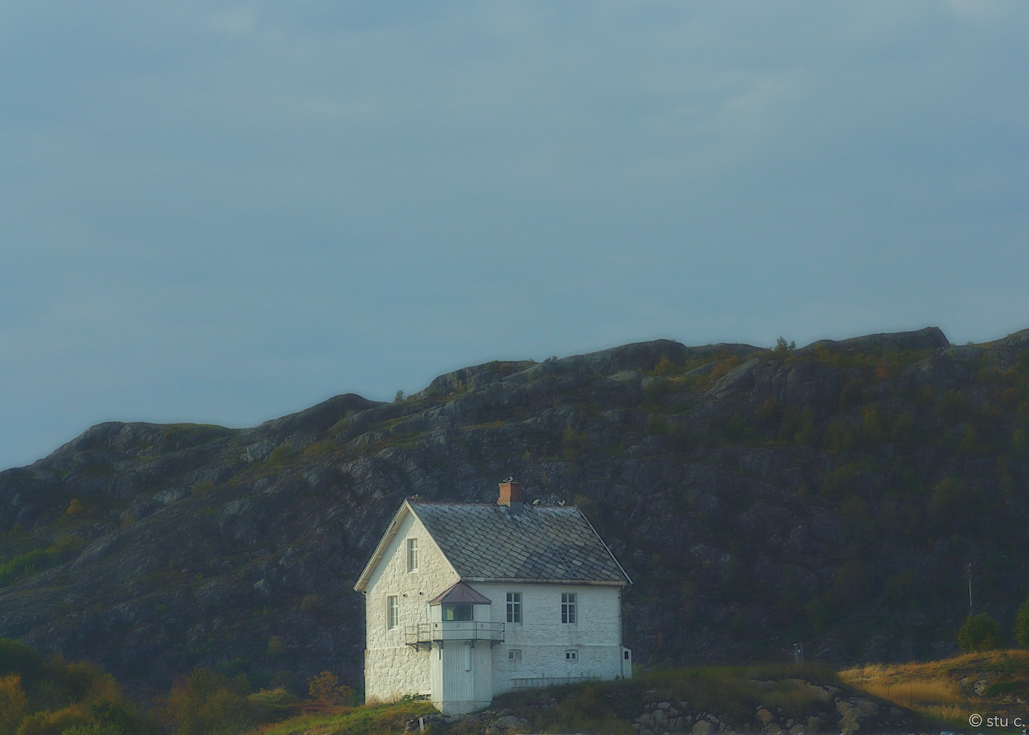 Aclassic and beautifully simpleNorwegian scene - this house on the rocky bluff overlooking the fjord.