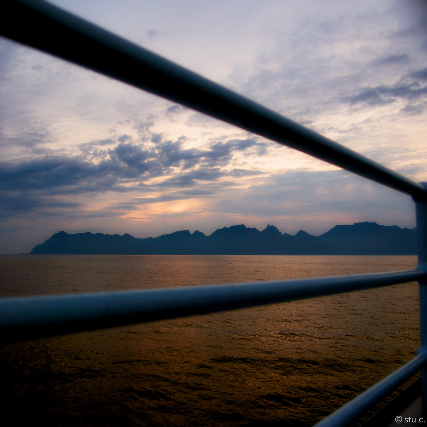 Sunset over the the mountains which comprise the Lofoten Island chain - this was the view from the ferry as we approached Moskenes.