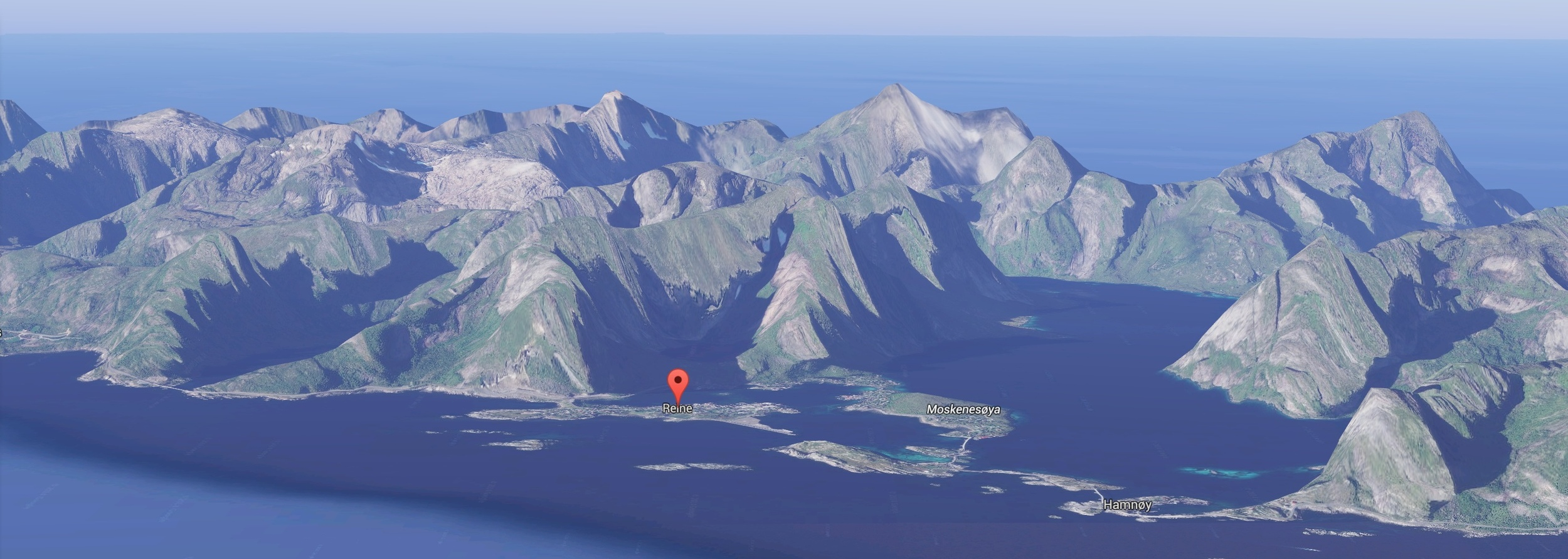 The Lofoten Wall - a Google Maps view of the area;  The North Atlantic beyond to the west, Reine safely on the eastern side