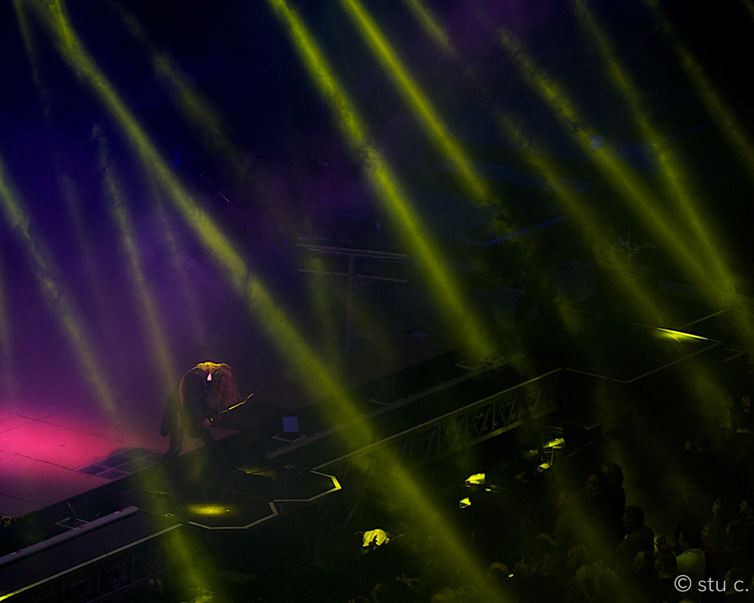 One of my favorite shots; the musician bowing, as if in abeyanceto the crowd, upward lights symbolizing their gaze
