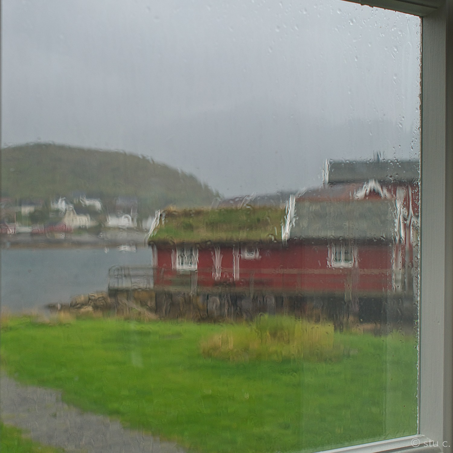In this rainy view, you can still make out the stilts on which this rorbu has been built