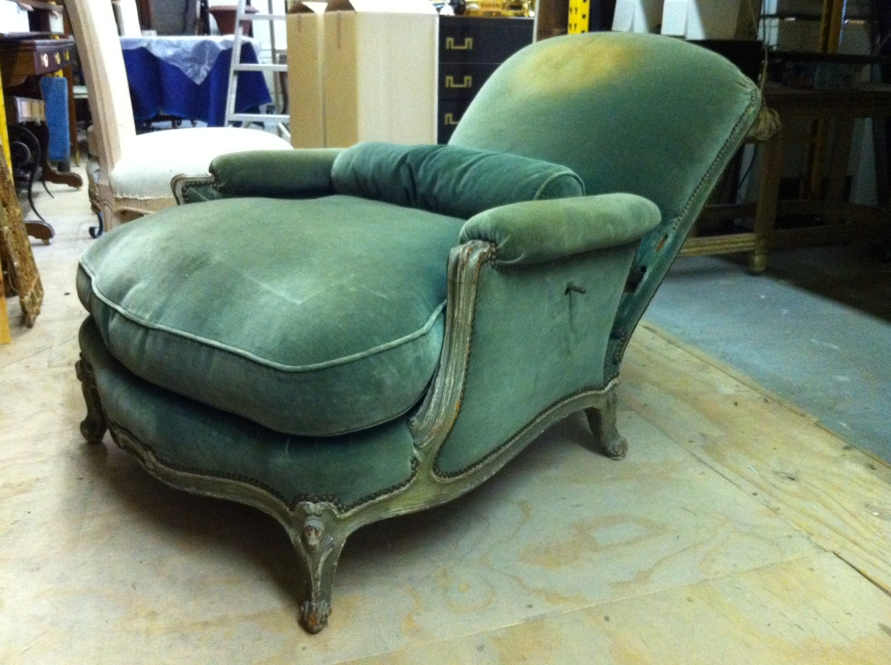 An original style Barroux in reclined position. One of the mechanical levers is underneath the arm.