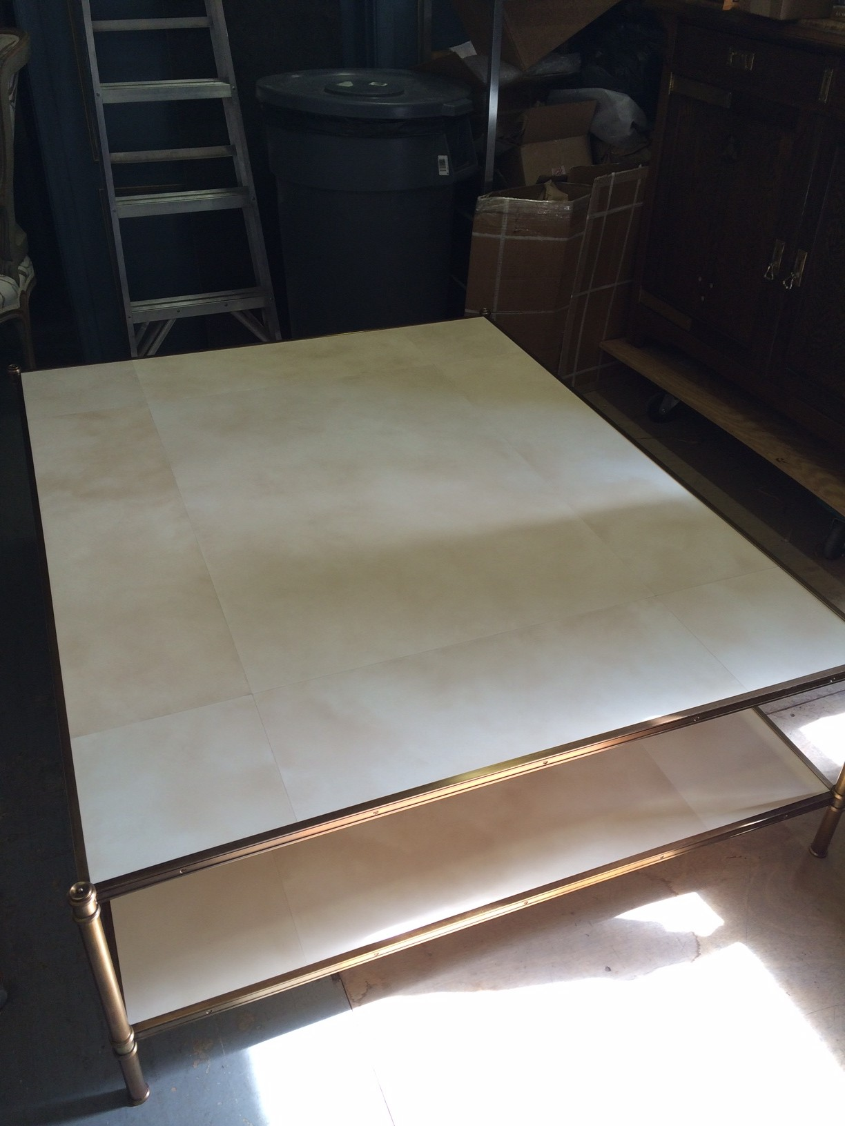 A large custom size Cole Porter with faux parchment shelves