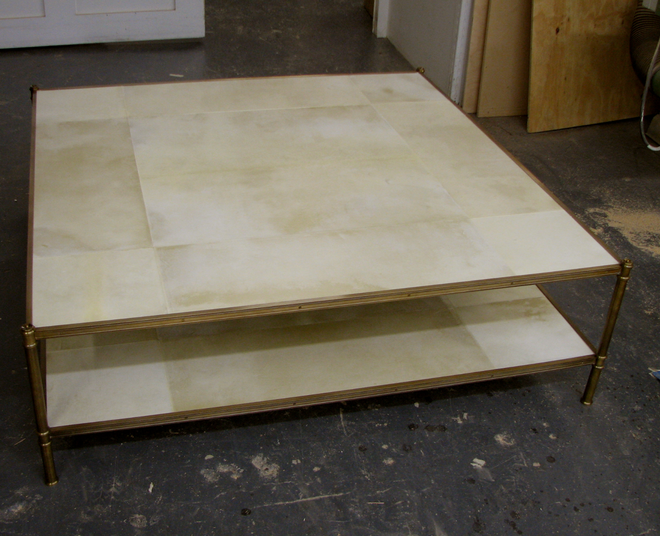 Large square custom Cole Porter coffee table with parchment covered shelves