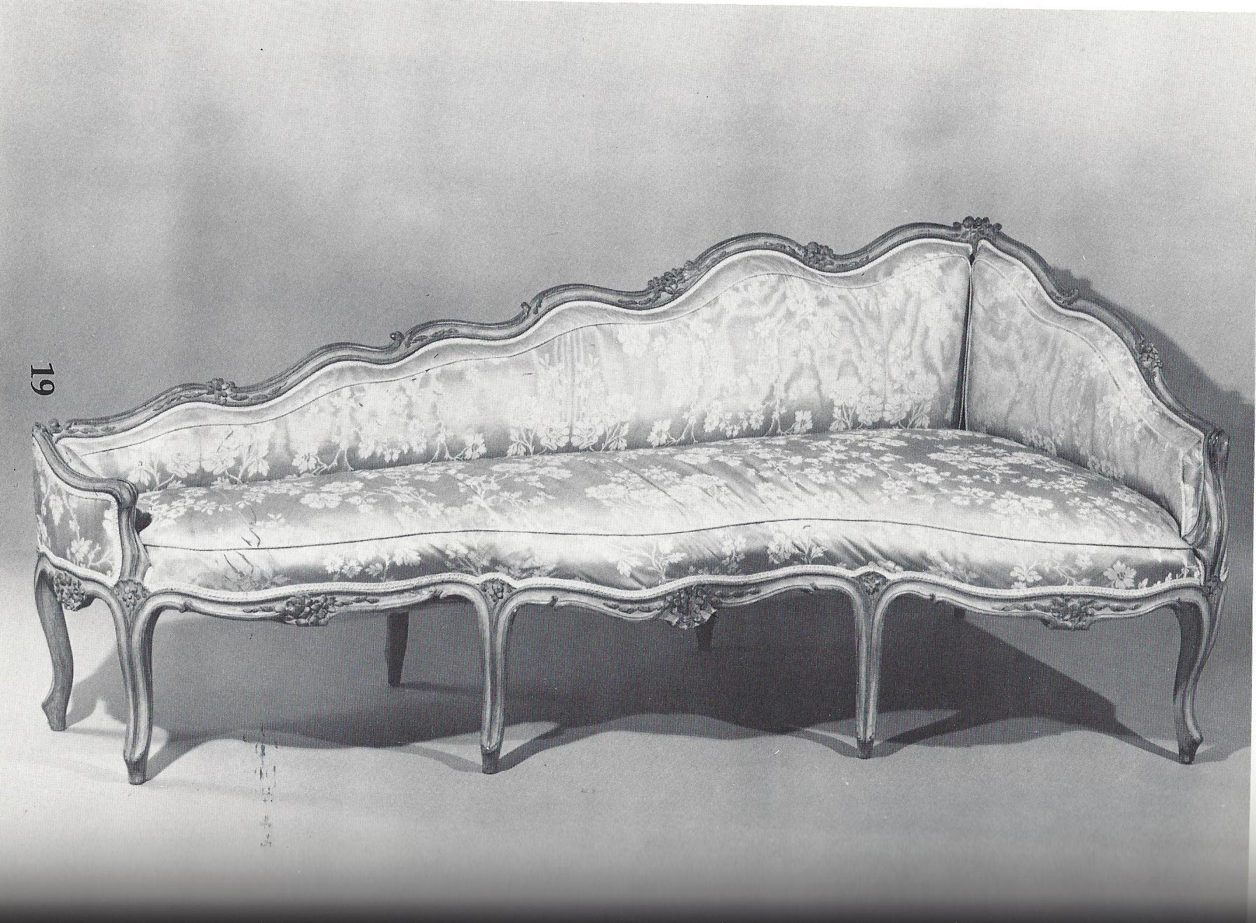 A Louis XV painted corner sofa, in the manner of Nicholas Heurtaut, likely used on either side of a fire place. Circa 1755. Plate 19 in The Master Chair-Makers Art.