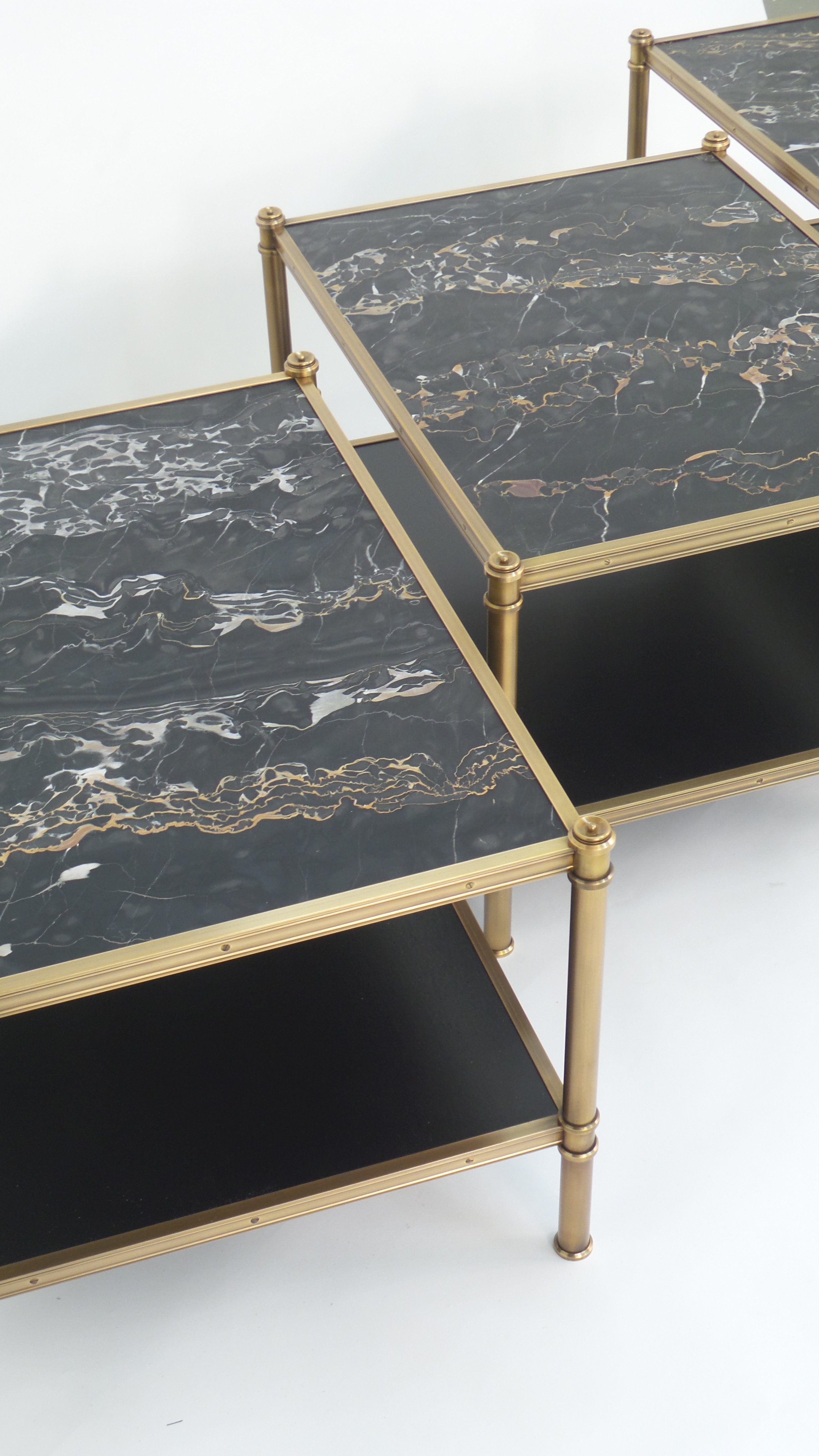 A set of Cole Porter coffee tables with Portoro marble shelves for Lichten Craig
