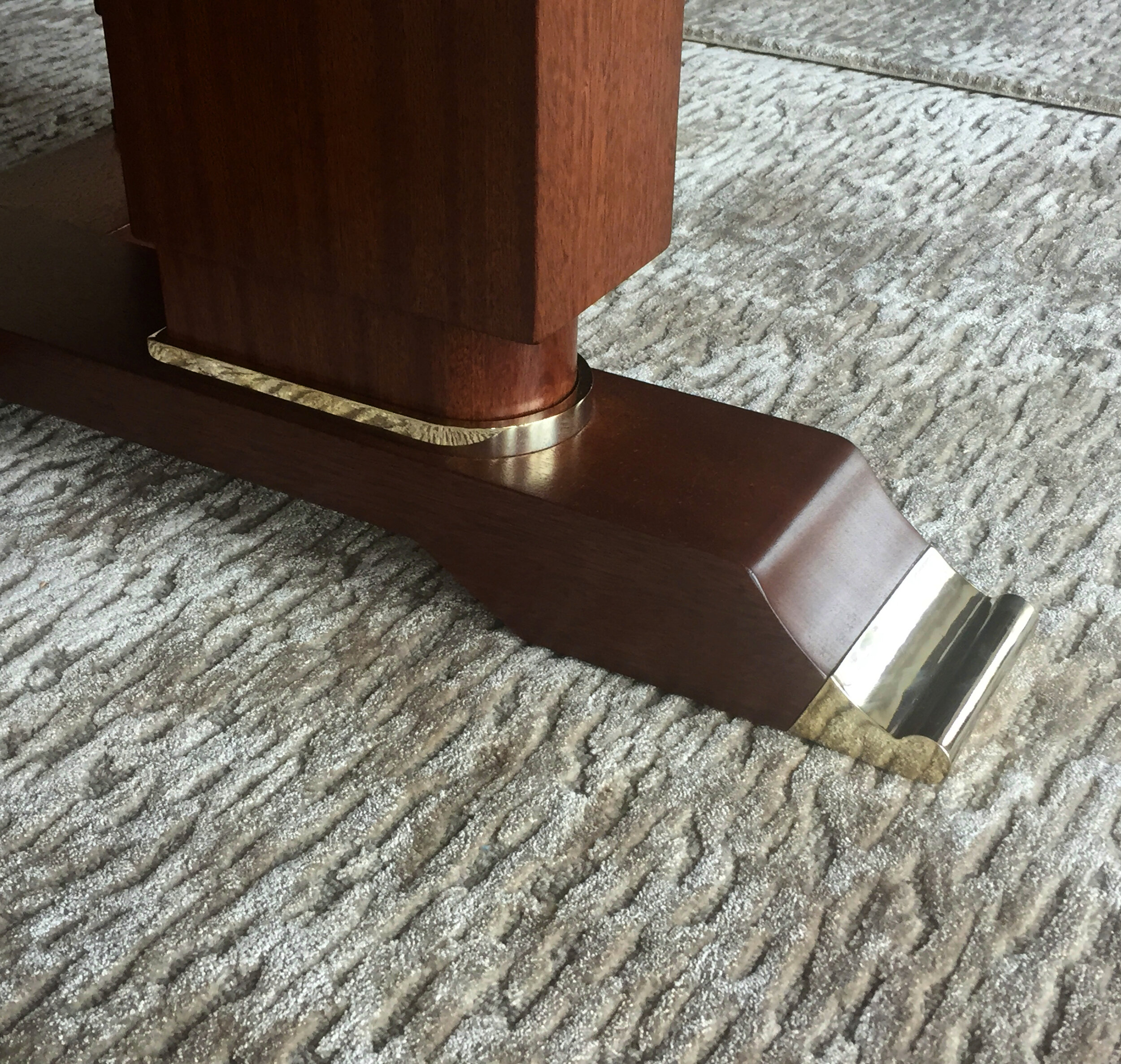 Custom brass shoe for Dining Table made by Victoria & Son for Alan Tanksley, Inc