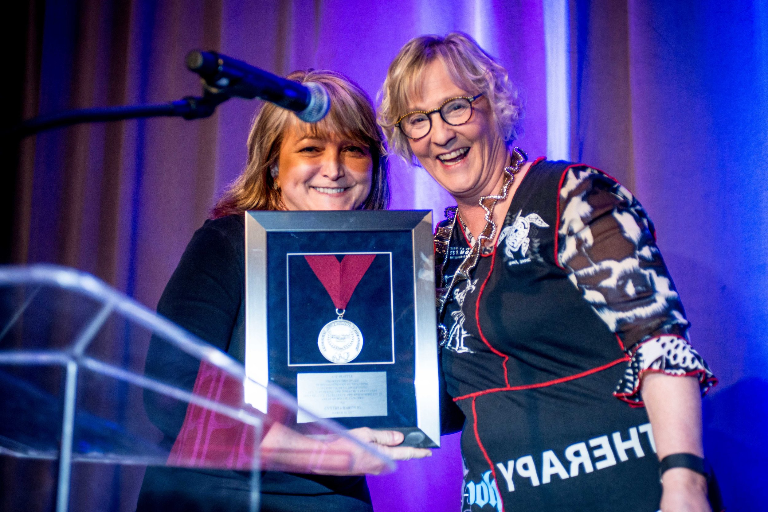 Cynthia Hartwig (R) with the AAF Silver Medal Award, presented to her by Mary Knight (L)