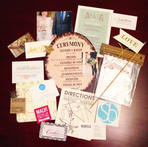 All the beautiful paper goods. That aqua number in the upper left is the menu for the event by yours truly. The flip side of it was my favorite, with hand drawn florals in the wedding colors.  Photo courtesy of  Sierra Piland Instagram .