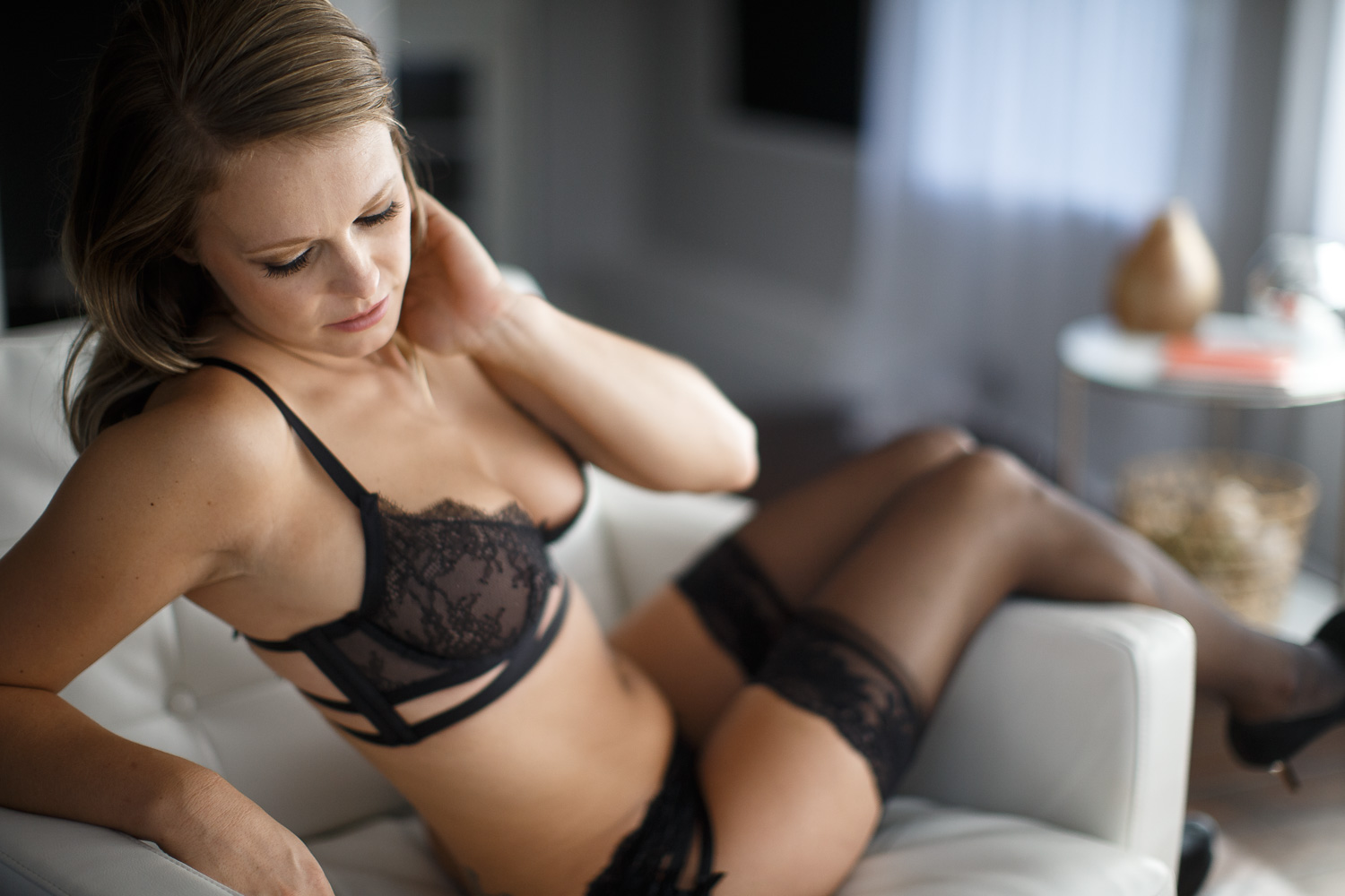 Boudoir model sitting on couch