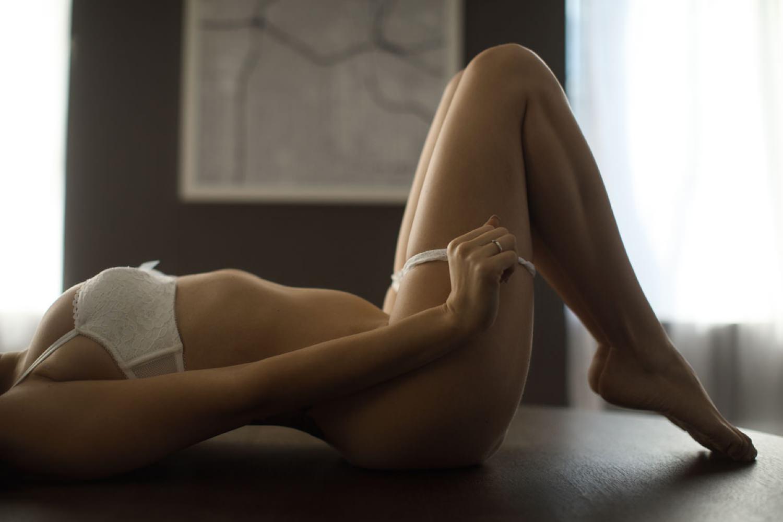 hot photo of a bride taking off her underwear