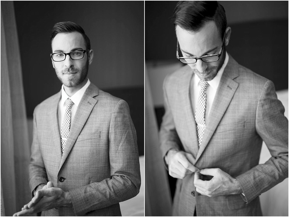 Male photographer in a suit and glasses