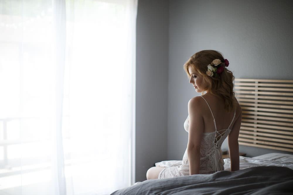 Boudoir Wedding Gift Back to Camera on Bed Photo