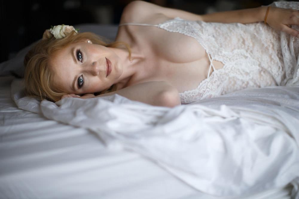 Boudoir Wedding Gift Lacy White Corset on Bed Photo