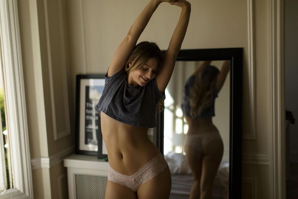 Model stretching upwards captured in LA Boudoir Session