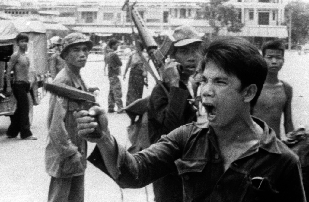 Khmer rouge soldier waves pistol ordering store owners to abandon their shops
