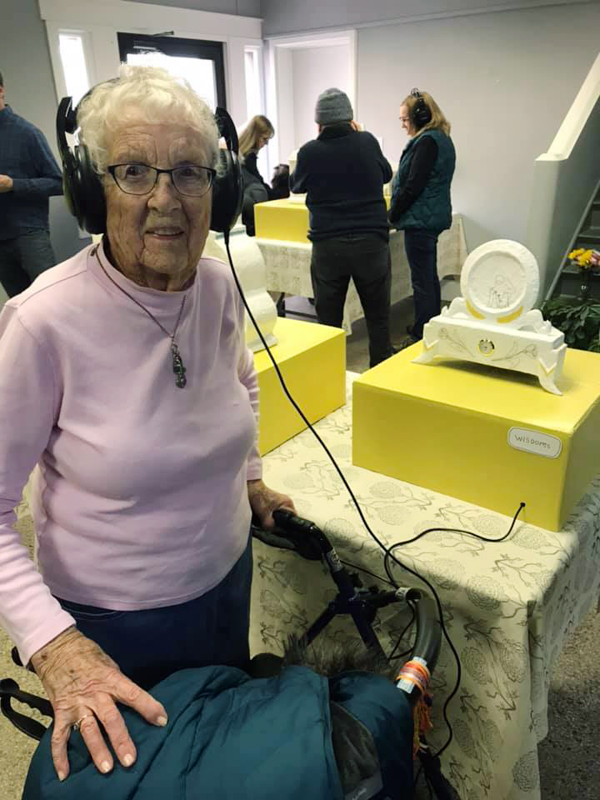 Time Sensitive acknowledges the importance of preserving memories and stories, especially those of the elderly population. 8 papier-mâché clocks act as time capsules and listening stations for audio, sharing stories and memories of the elderly. 103 year old Evie takes a listen.