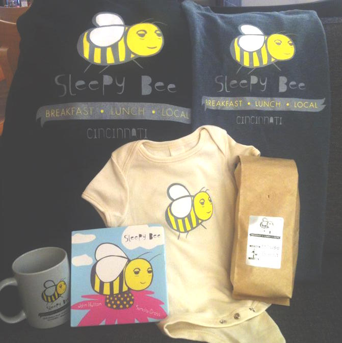 And they also have adorable apparel, coffee mugs,napkins ( love!) , and ohmygoodness a onesie!!!