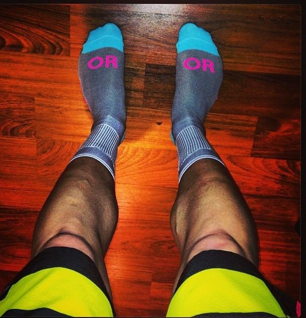 Ryan models the socks, for all genders.