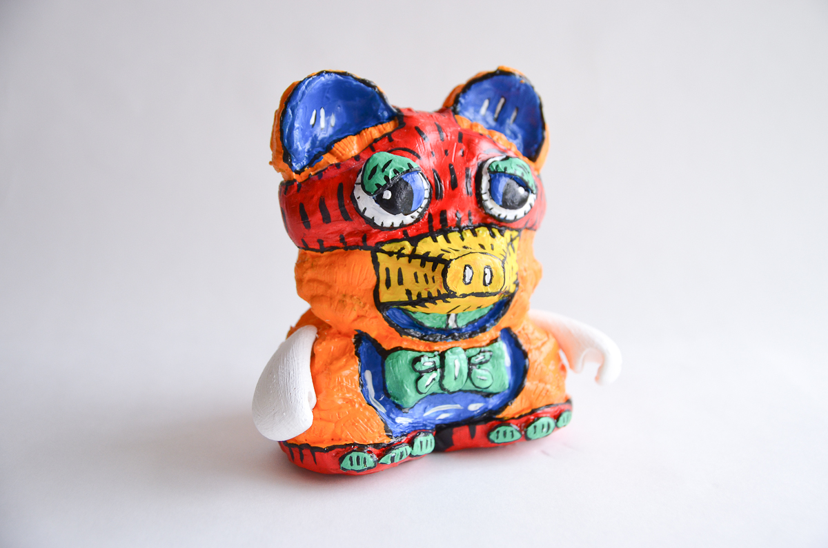 "Mapache Bear, Claudia Zapata, 2014; acrylic on resin, hand-casted & hand-painted; 7"" x 6"" x 5""; Weight: 1.5 lb; Edition of 1"