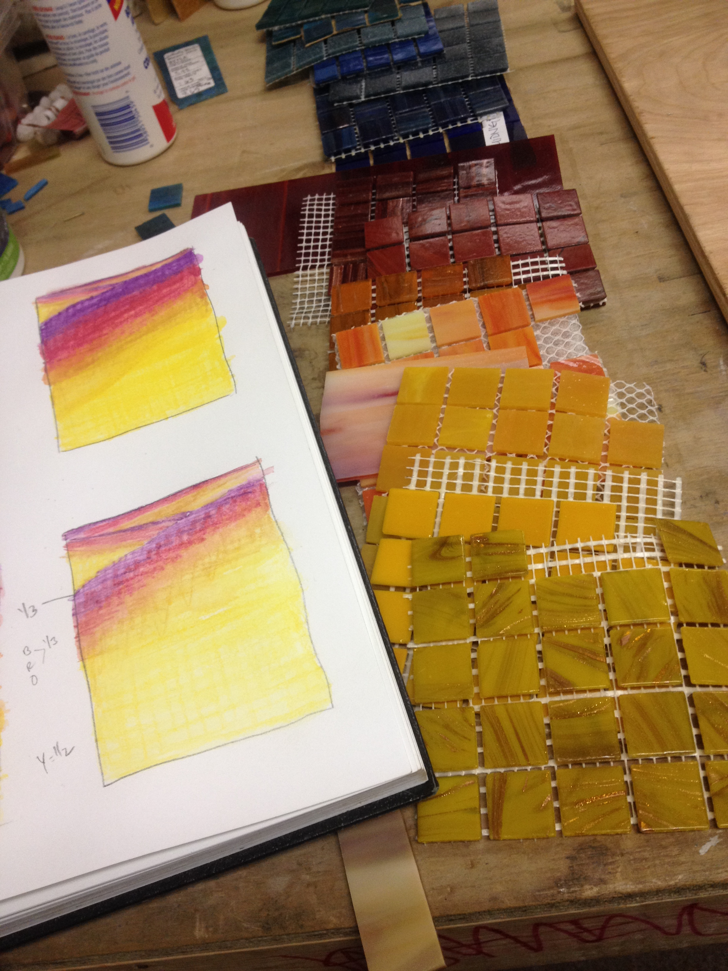 Sketching and selecting material for a mosaic commission.