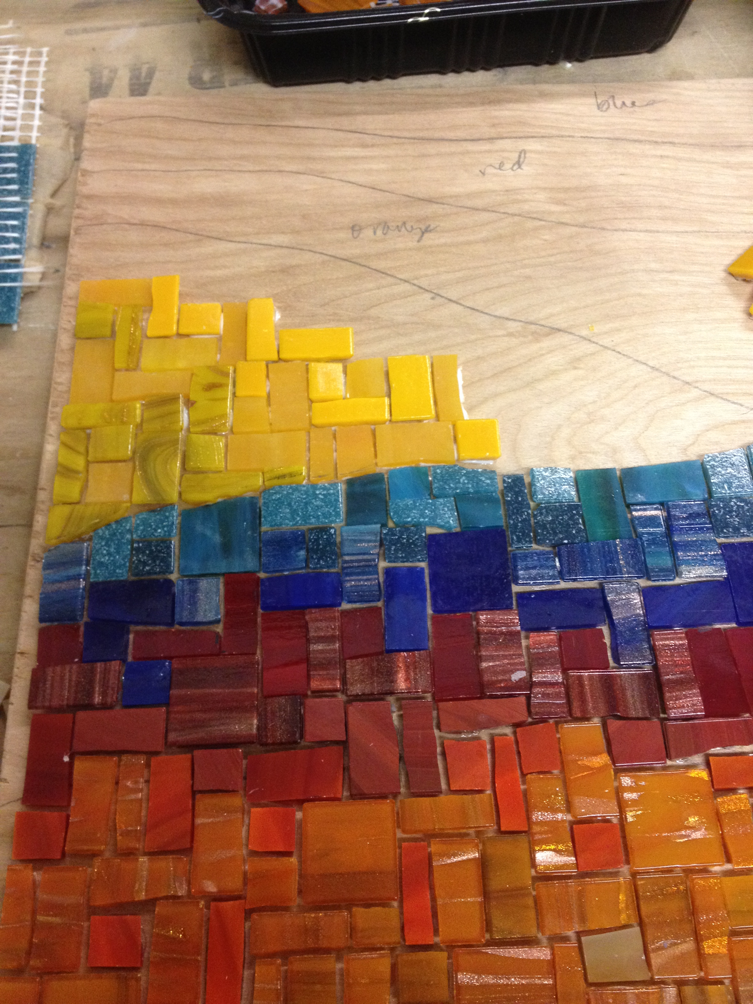 Almost done gluing the mosaic.
