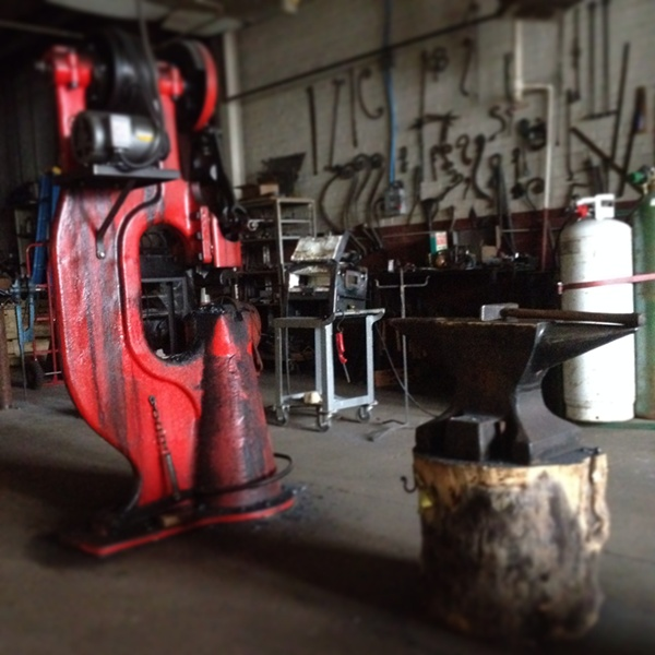 Our refurbished 1918 50 lb Little Giant in the metal studio.