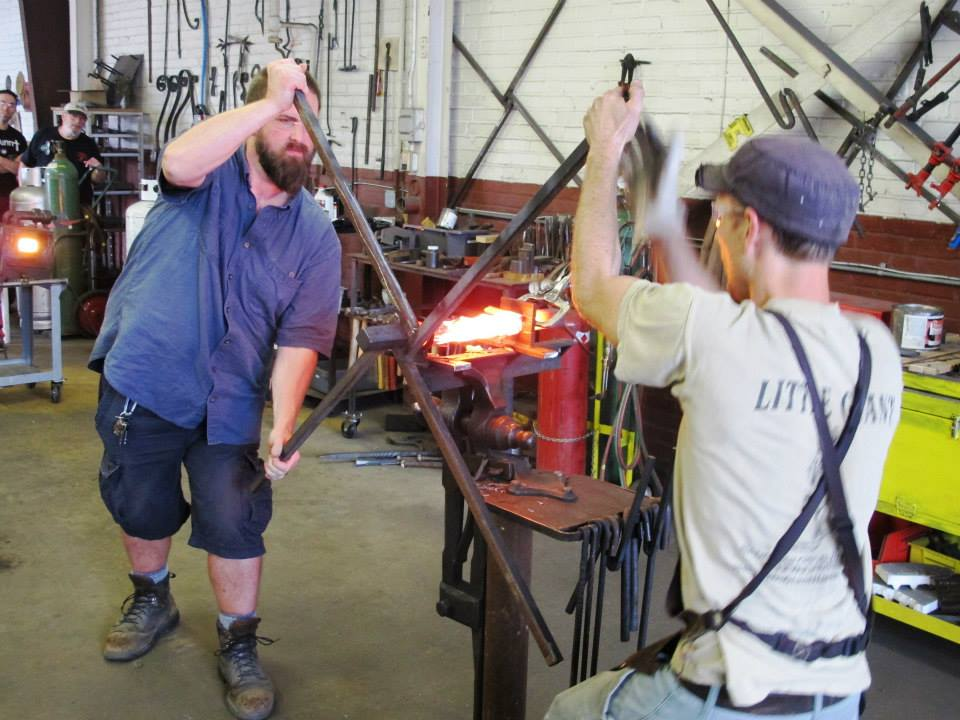 """There are several steps to create the twist. The first is to chase a line on each side of the bar stock. """"Chasing"""" is basically drawing a line in the metal with a chisel. The second step, shown here, is to twist the bar."""