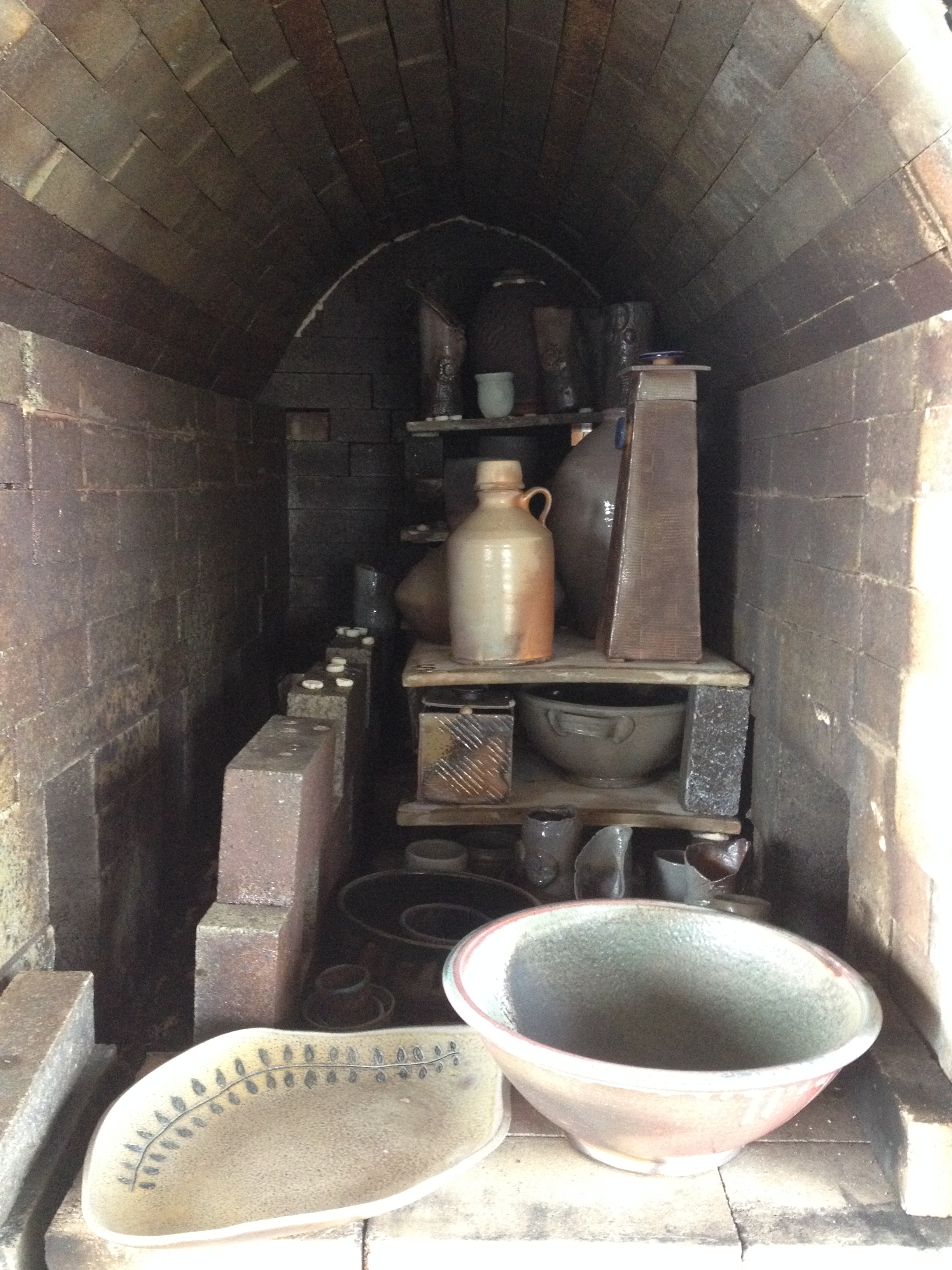 One side of the kiln before they began unloading over 600 new pots and other pieces!