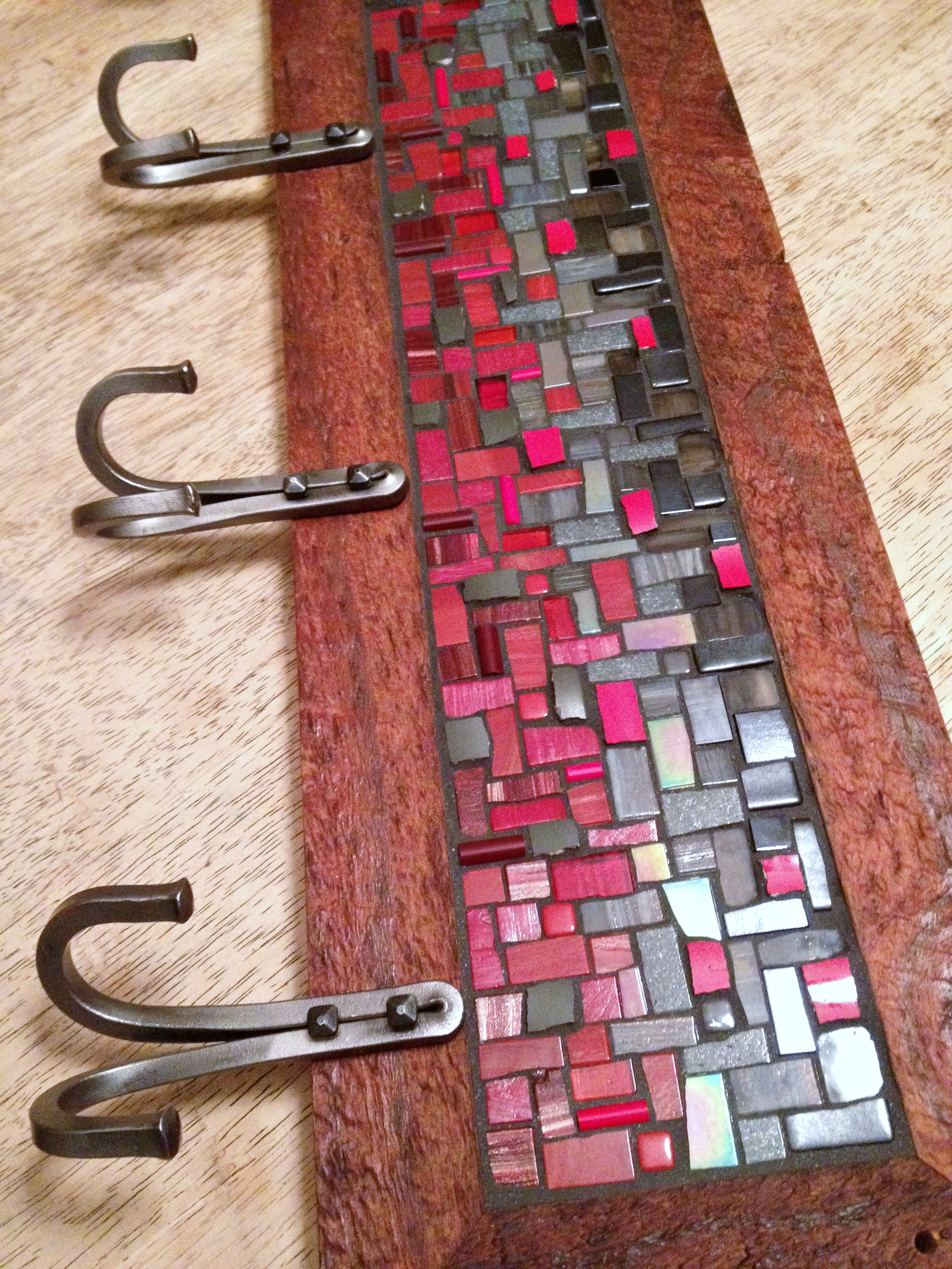 Red and gray custom mosaic coat rack with hand forged double U hooks