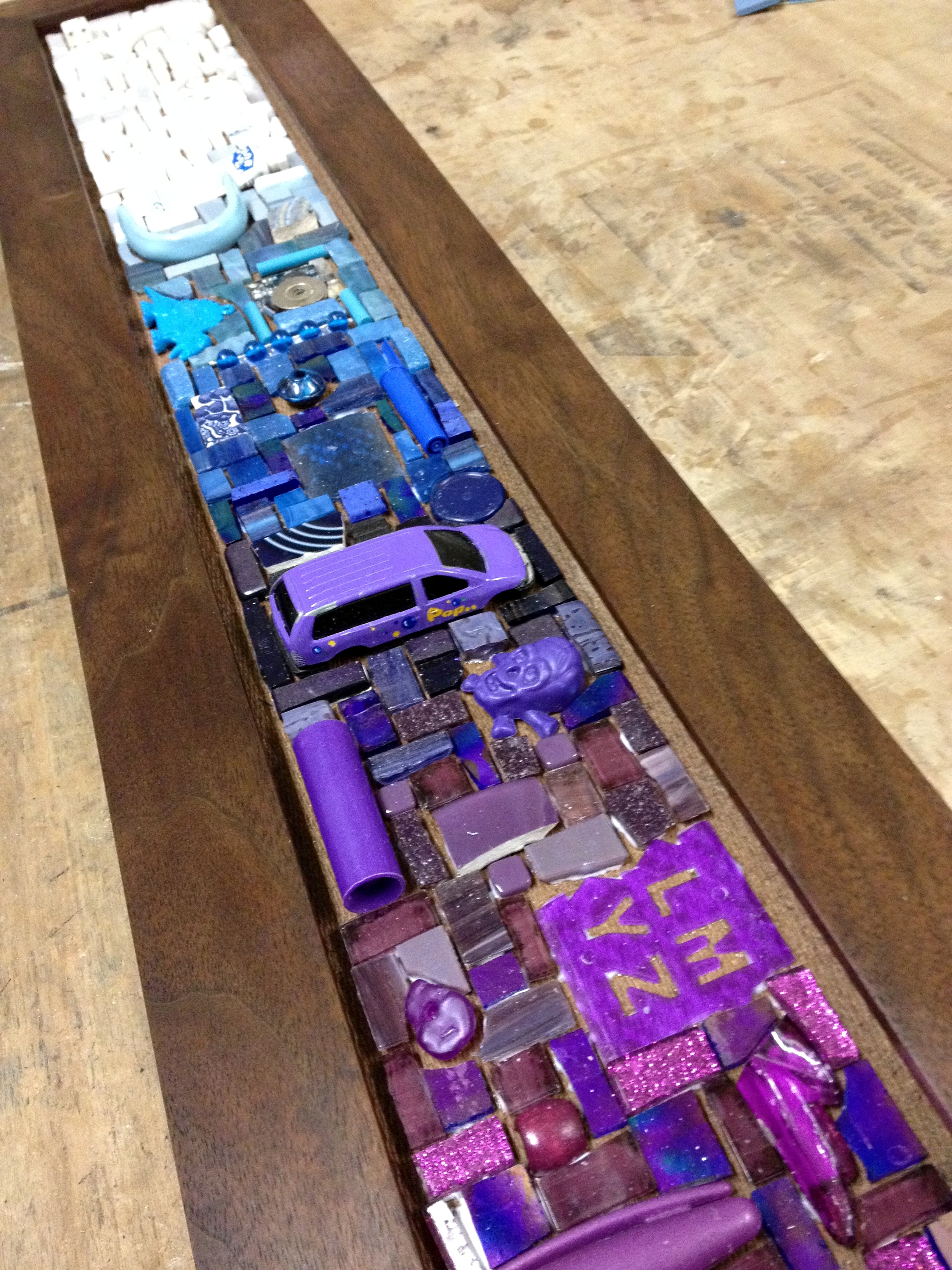 Custom six hook mosaic coat rack in purple, blue, and white