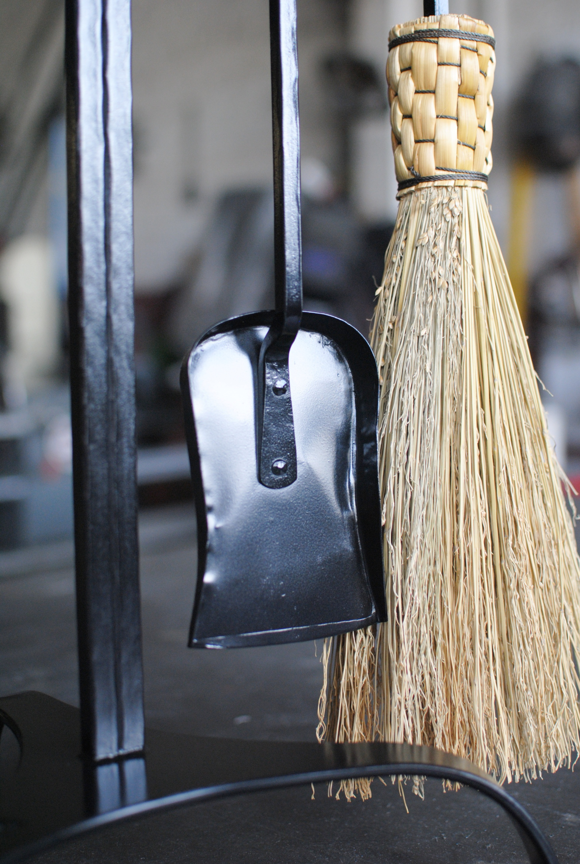 Shovel and broom detail of custom fireplace tool set