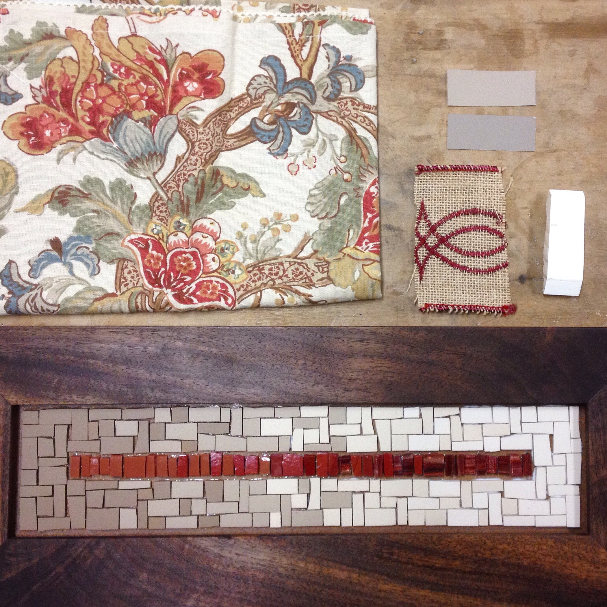 Custom mosaic coat rack with wall paper and fabric samples to aid in color selection
