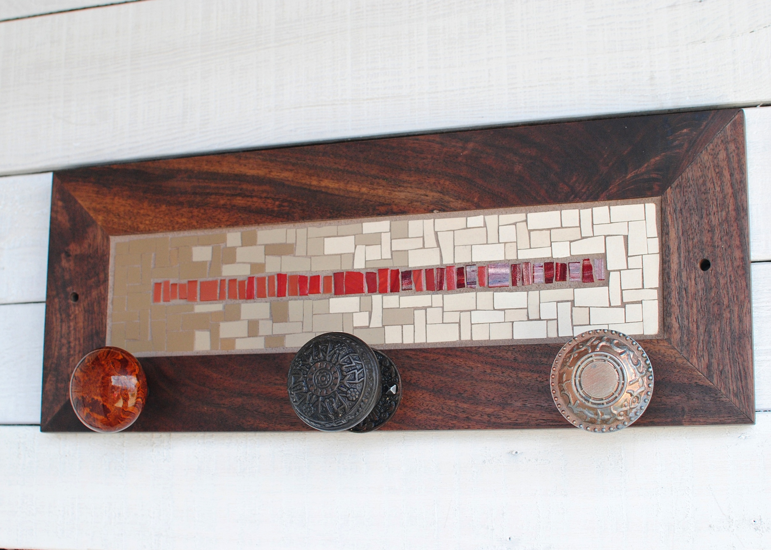 Custom mosaic coat rack with vintage door knobs for hooks