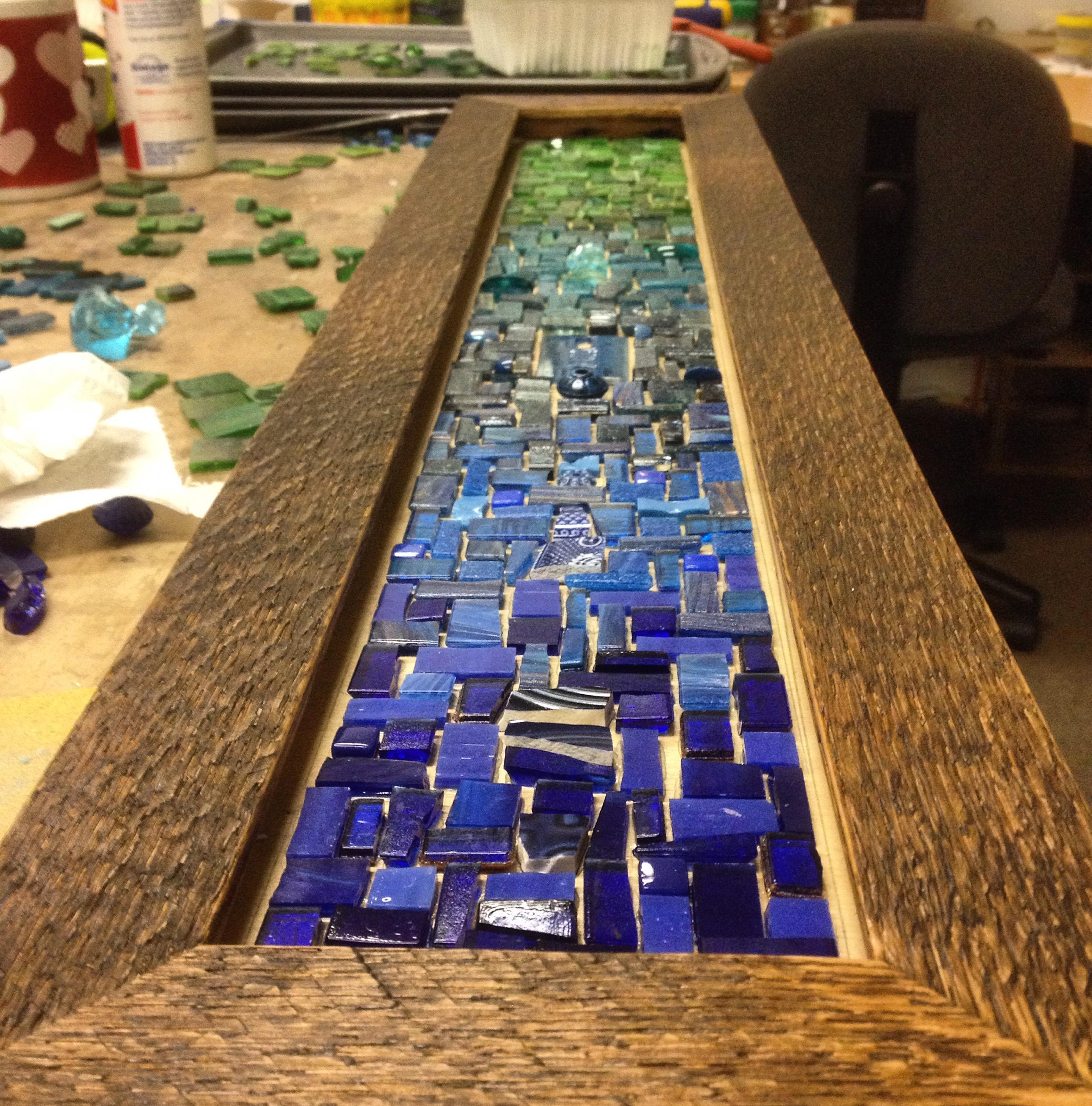 Custom six hook mosaic coat rack in blue and green in the mosaic studio