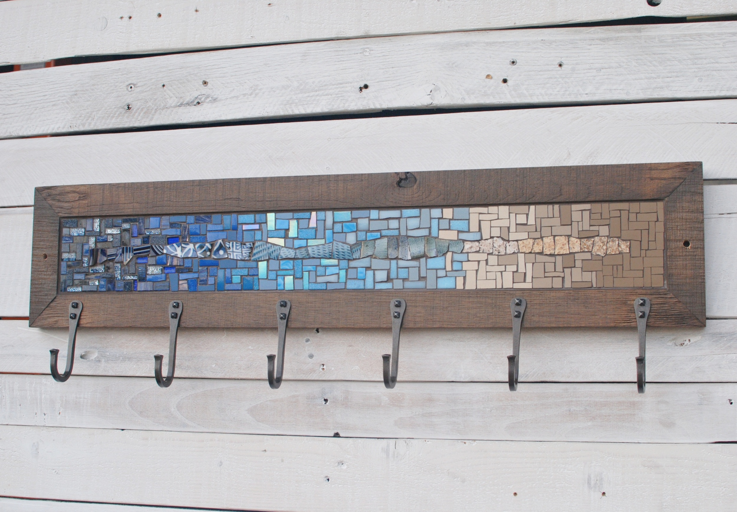 Custom six hook mosaic coat rack in blue and tan with hand forged traditional U hooks