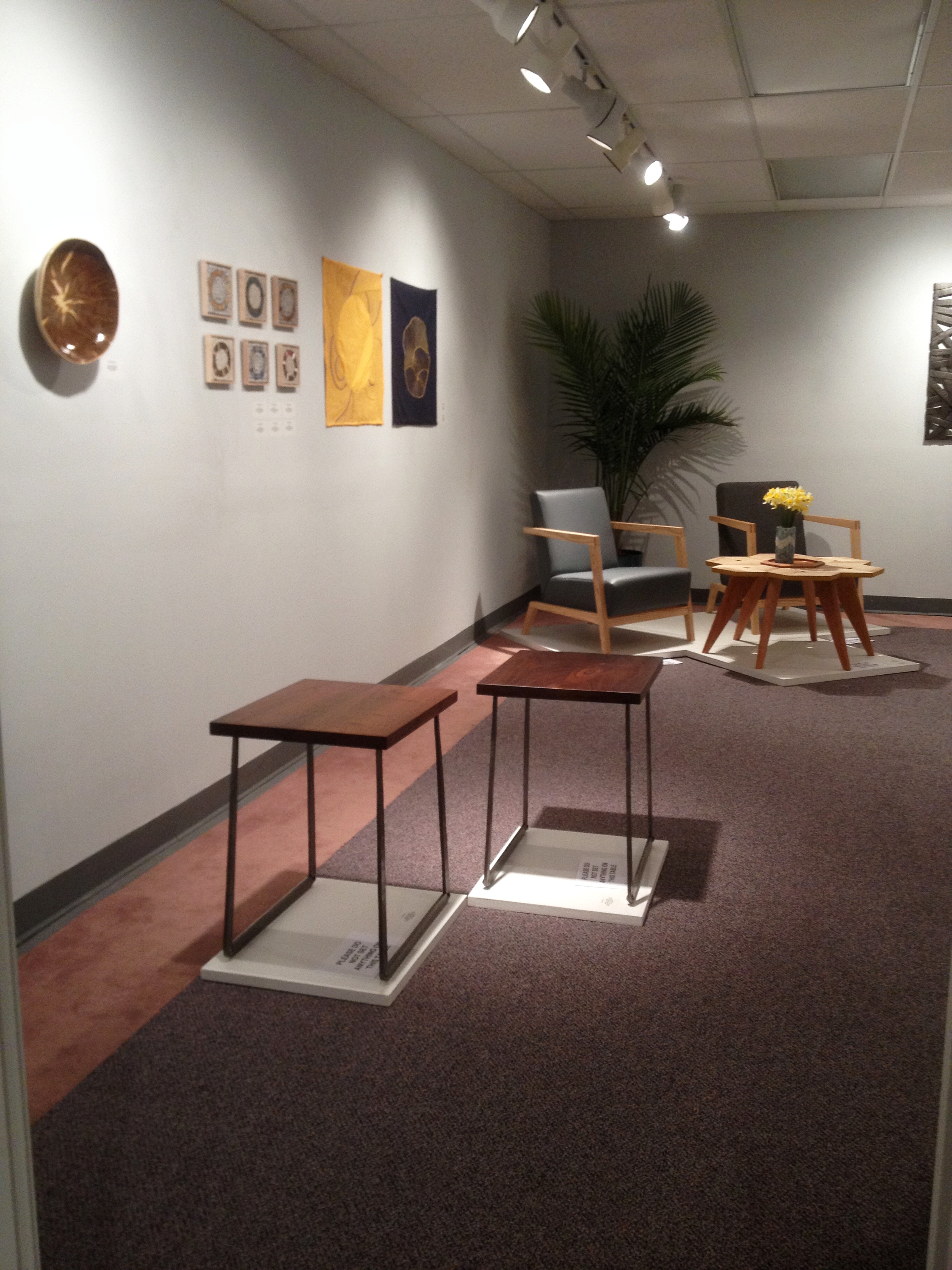 Walnut and forged steel tables at GROWTH exhibition