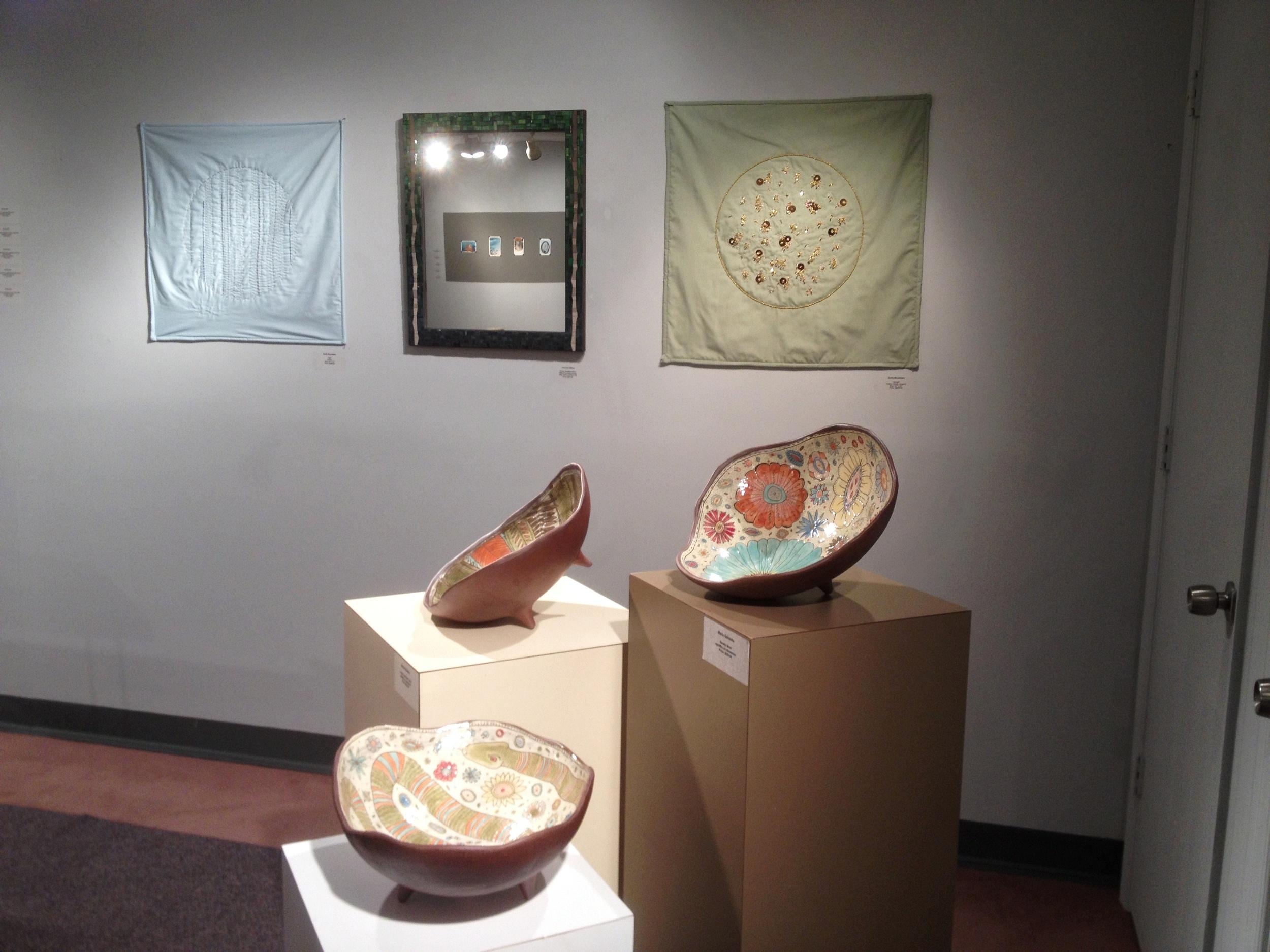 Mosaic mirror at group show
