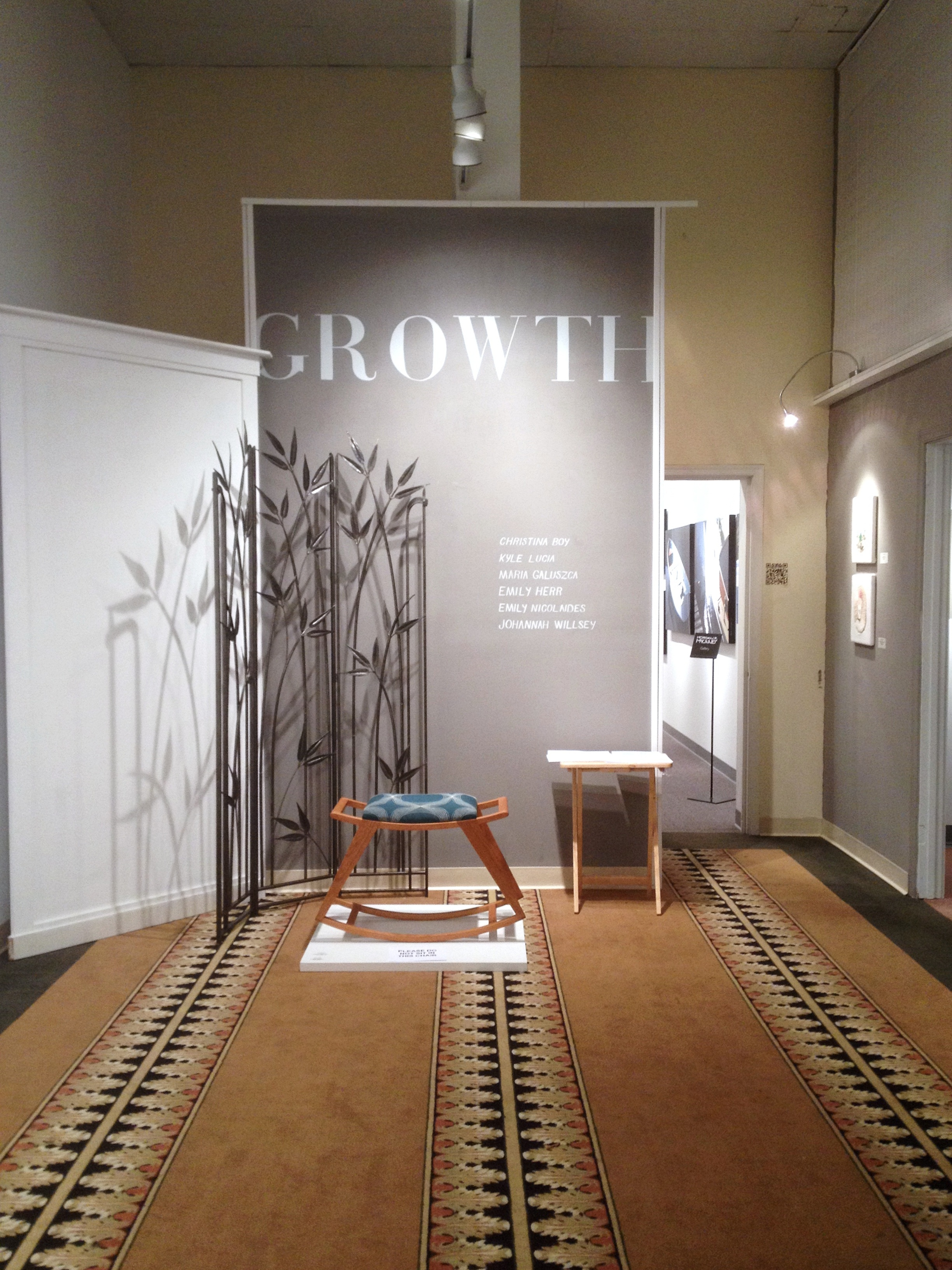 GROWTH exhibition hand-painted sign and  hand forged bamboo screen