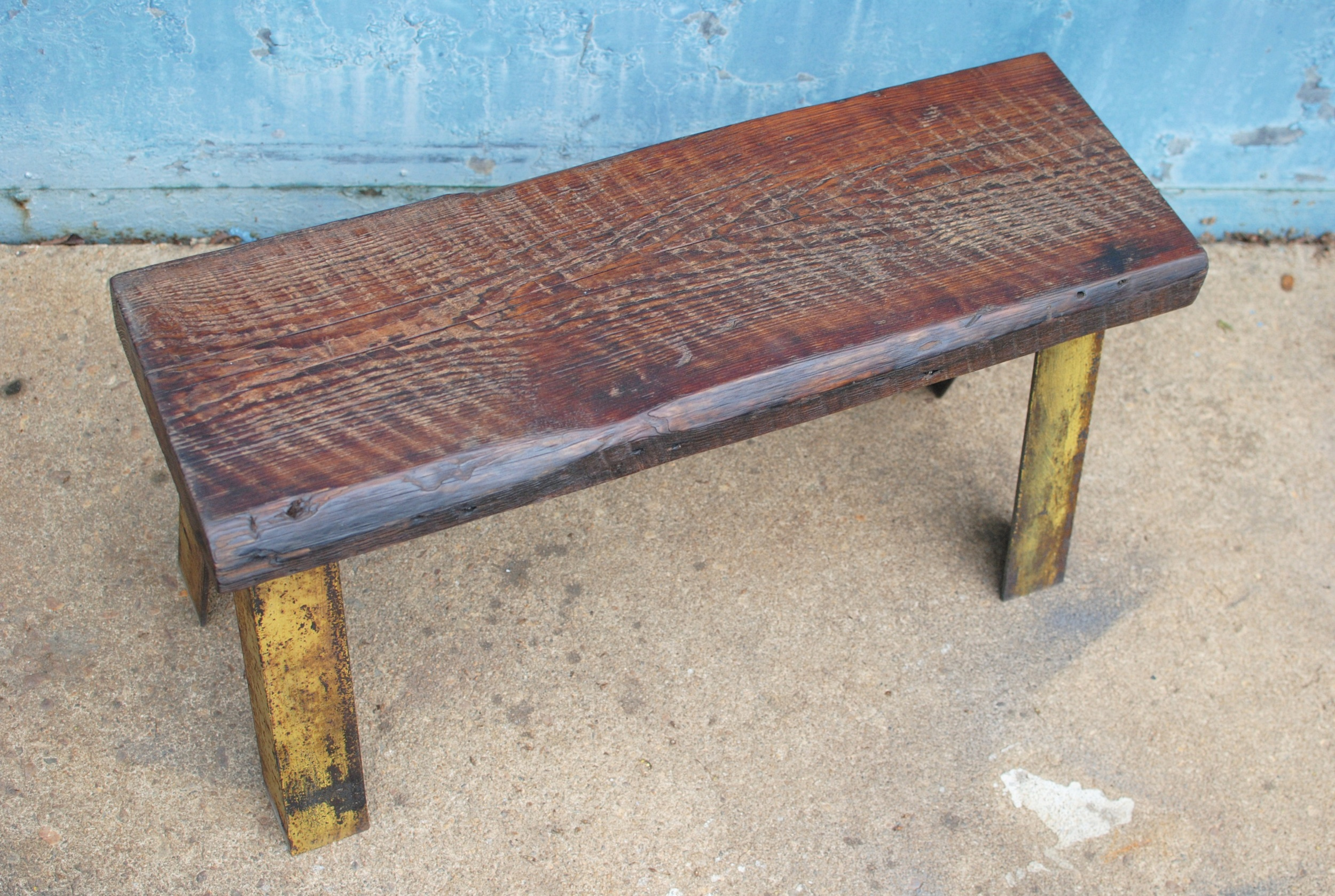 Bench with reclaimed wood seat and industrial metal legs