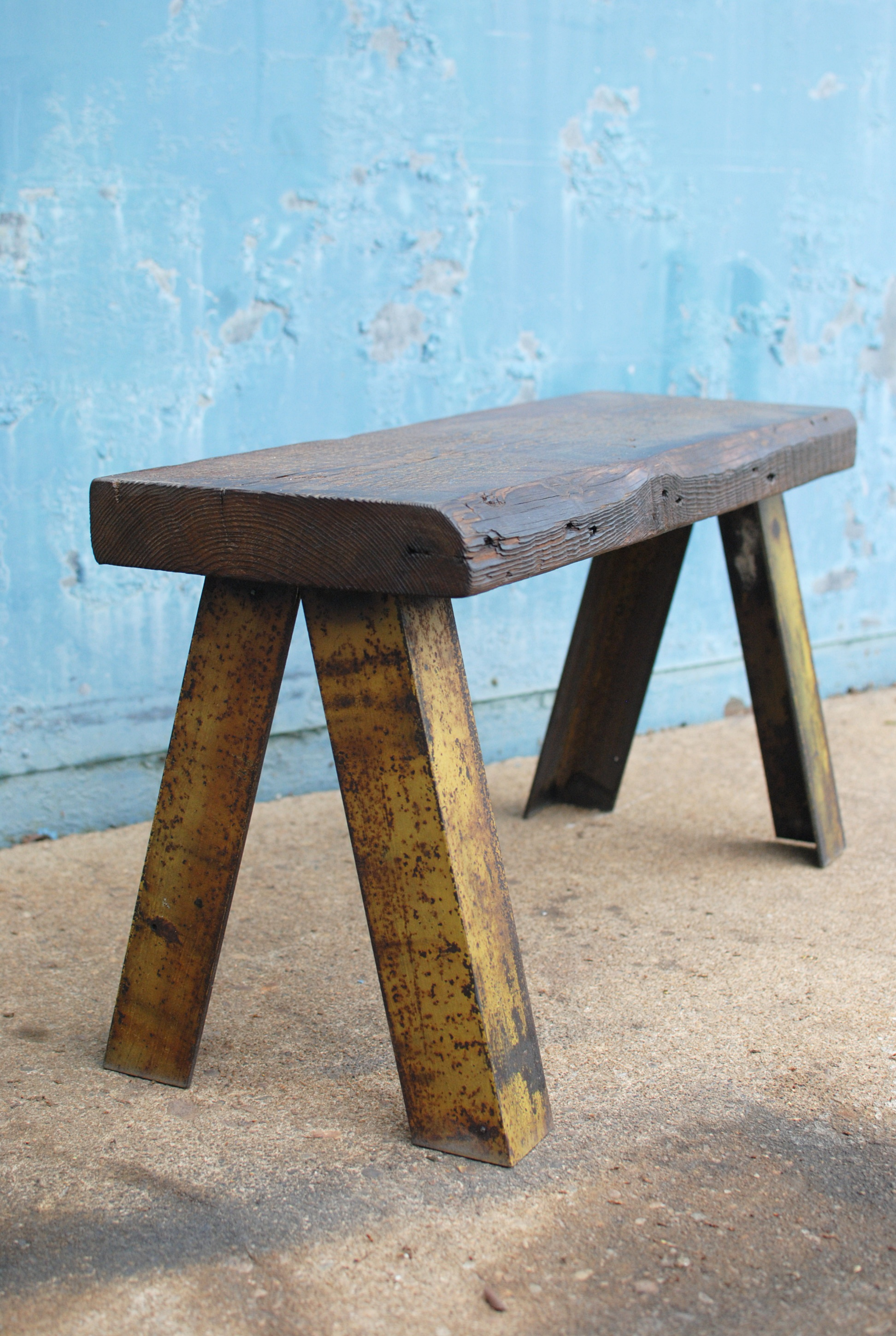 Interior bench with wood seat and metal legs
